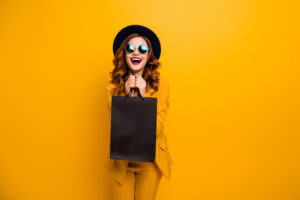 Close up photo beautiful she her lady very glad black friday laughter carry packs perfect look buy buyer birthday sale discount wear specs formal-wear costume suit isolated yellow bright background.